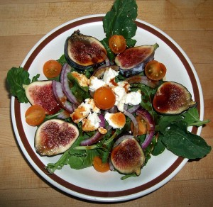 Fig, tomato, cheese salad dressed with cider syrup