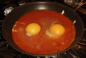Fresh Eggs into Tomato Sauce